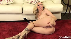 She has her mouth all over a huge dildo before it explores every inch of her snatch