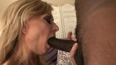 Sexy blonde MILF blows his black rod and gets her twat split open