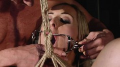 Blonde cutie gets her inviting bunghole stretched while tied up