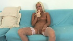 Tanned blonde toy fucks herself on the couch to get nice and wet