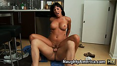 Lezley Zen gets down on the kitchen floor and rides a young cock