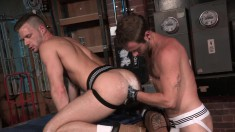 Muscular stud in a black jockstrap spreads his legs to get his ass licked and fisted