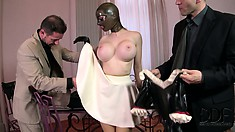 Lucy goes from latex whore to latex maid and kisses his shoes