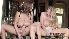 Busty babes Eva Notty and Kelly Madison drill their pussies with big glass dildos