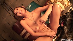 Kinky japanese beauty stuffs her bushy pink cunt with a glass toy