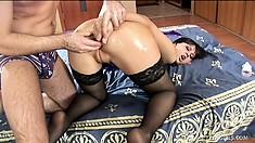 Magnificent brunette milf in black stockings gets her holes drilled like she deserves