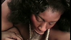 Fat ebony lady shoves a black dick down her throat before it explores her needy cunt