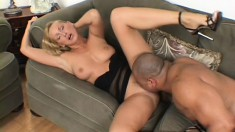 Blonde gets a couple of black cocks to blow and nail her and give her a DP