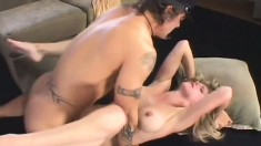Busty blonde with long legs sucks a big dick and receives it deep in her fiery cunt