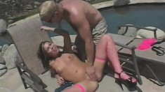 Cute young brunette in pink fishnet stockings gets fucked hard outside