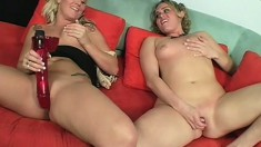 Naughty blonde cougar teaches a lovely young babe how to suck and fuck a big cock