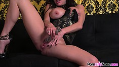 Busty brunette slut makes her pussy run wet with a glass dildo