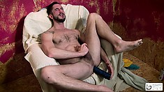 Hot Spanish stud strokes his big dick and slides a dildo up his ass