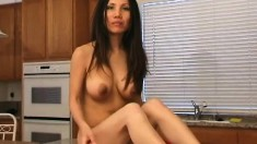 Asian beauty with big boobs Mayuko plays with sex toys in the kitchen