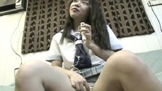 Naughty Japanese schoolgirl has a sex toy pleasing her fiery snatch
