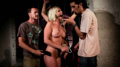 Busty blonde is tortured and humiliated by her masters in the dungeon