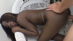 Provoking black beauty Lady Armani spreads her legs for a white stick