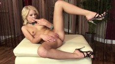 Sexy slim blonde in high heels spreads her legs and fingers her peach