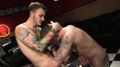 Two ripped and tattooed hunks get better acquainted through oral and anal sex