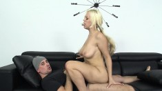 Bodacious blonde has a horny guy banging her shaved twat on the couch