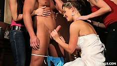 They blindfold her and bring out the surprise, a thong wearing stripper