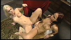 Two exciting lesbians take turns banging each other's holes with a strap-on dildo