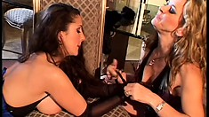 Two smoking hot lesbian bitches in fancy corsets get real freaky