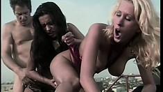 Wild babes Zana and Nikita Denise take turns feeding their hungry holes a stiff cock