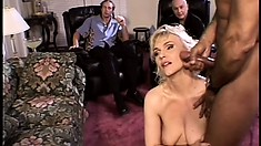 Busty blonde has two black guys fucking her pussy and her man watches