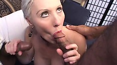 Short haired mature woman with big boobs enjoys a double penetration