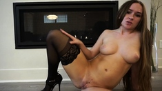 Masturbating pussy babe using sex toy through her stockings
